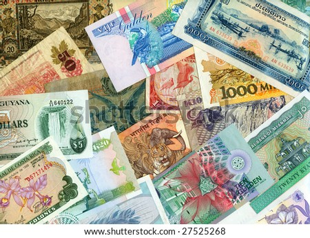Currencies from around the world with flora and fauna. - stock photo