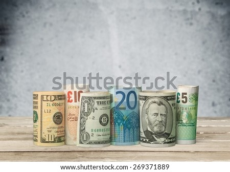 Currency. Banknotes in a line - Rolled Up (XXXL) - stock photo