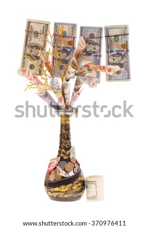 Currency bills on a handmade money tree isolated on white background - stock photo