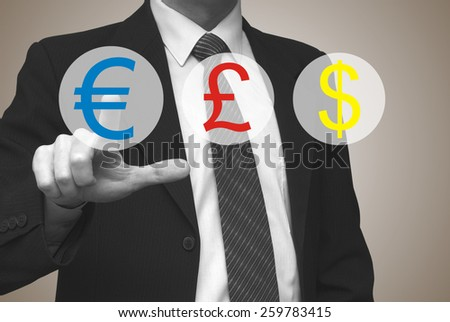 Currency concept, businessman pressing euro button on virtual screen - stock photo