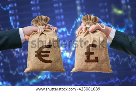 Currency exchange concept. Hands holds bags full of money - British pounds and Euro. - stock photo