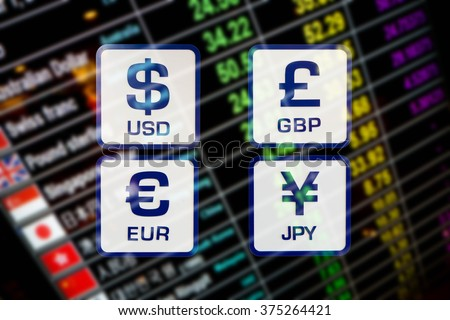 currency exchange rate icons signs on blurred background of digital display board - stock photo
