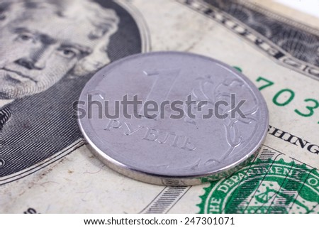 Currency exchange. Russian ruble coin lies on a banknote two dollars US - stock photo