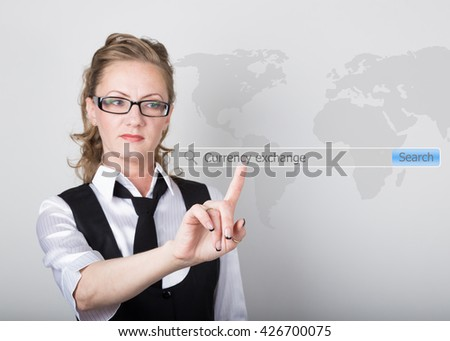 currency exchange written in search bar on virtual screen. Internet technologies in business and home. woman in business suit and tie, presses a finger on a virtual screen