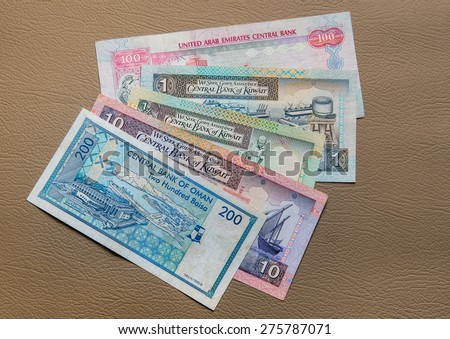 Currency from Gulf countries - UAE Dirham, Kuwaiti Dinar, Omani riyal. - stock photo