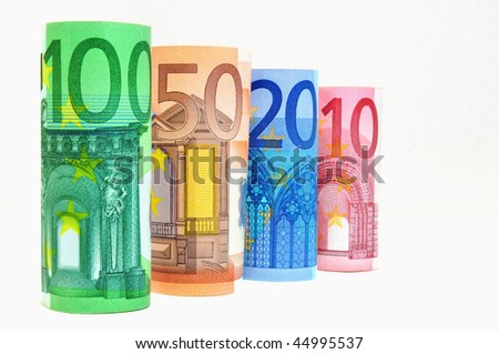 Currency in a row of 10 to 100 Euro banknotes