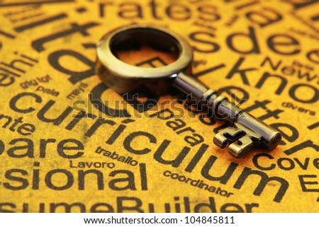 Curriculum and old key - stock photo