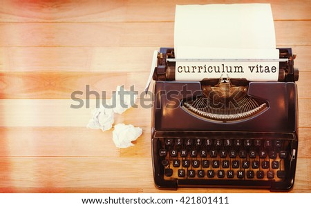 Curriculum vitae message on a white background against typewriter with paper on table in office - stock photo