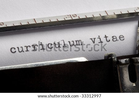 curriculum vitae written on an old typewriter - stock photo