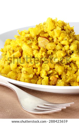 Curried cauliflower is spicy yet mild, perfect for a vegetarian main course or side dish - stock photo