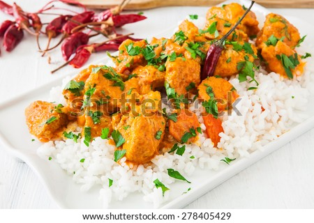 Curried Coconut Chicken with red hot chili pepper and rice - stock photo