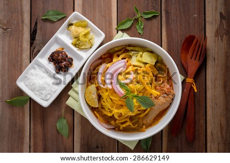 Curried Noodle Soup (Khao soi) with coconut milk, Northern Thai  cuisine. - stock photo