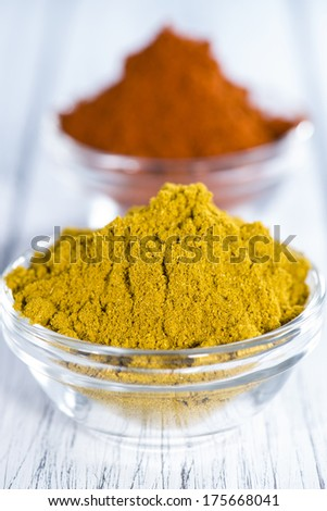 Curry and Paprika Powder in small bowls