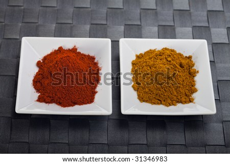 curry and paprika powder on small plates