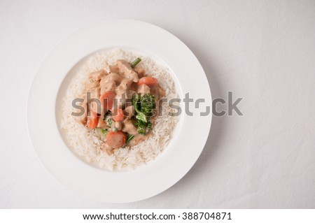 curry chiucken with mushroom sauce and fresh vegetables - stock photo