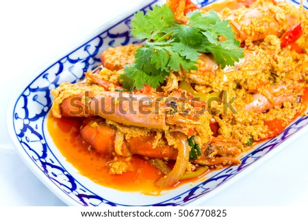 Curry fried shrimp with coconut milk on white background