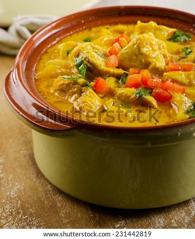 Curry in  bowl on a wooden table. Selective focus - stock photo