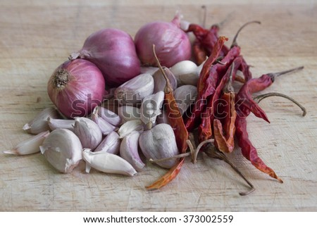 Curry Ingredients on wood - stock photo