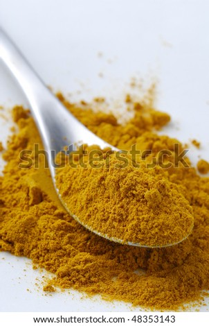 Curry Powder on the spoon - stock photo