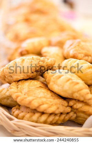 Curry puff in a basket. From Thialand. - stock photo
