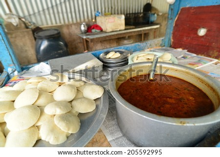 curry served with rice and white naan - stock photo