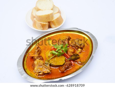 Curry Soup Of Goat Meat With Bread On White Background