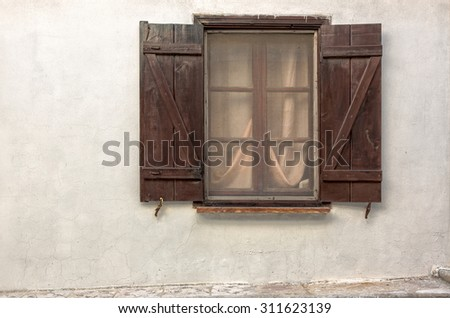 Curtain and Window,exterior of an old house in Bozcaada streets - stock photo