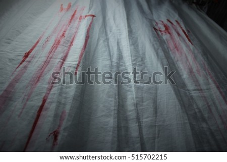 Curtain covered with bloody hand marks