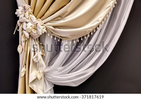 curtain from tulle and a silk curtain with decorative pickup with flowers - stock photo