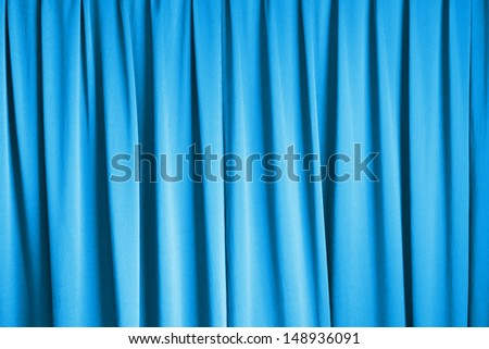 curtain of cinema stage background, blue dramatic tone - stock photo