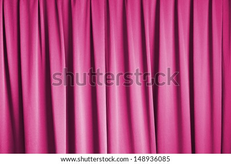 curtain of cinema stage background, pink dramatic tone - stock photo