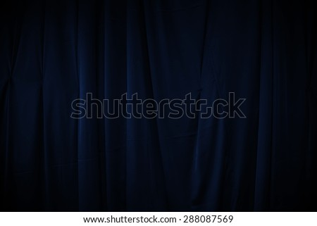 curtain or drapes dark blue background - stock photo