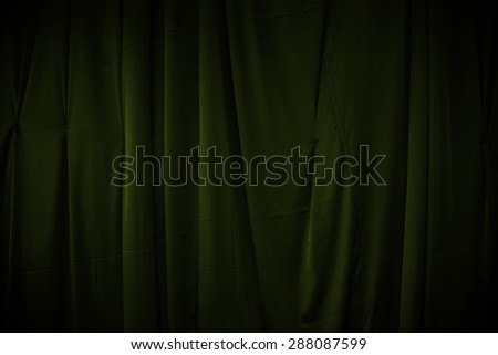 curtain or drapes dark green background - stock photo