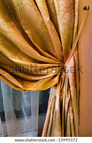 curtain with an ornament in the modern flat - stock photo
