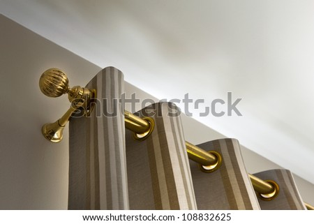 Curtains and gilt metal rod - stock photo