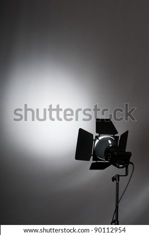 Curtains and projector lights wtih space for your text - stock photo