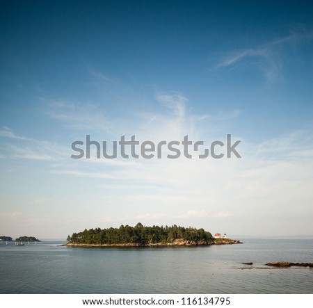 Curtis Island and lighthouse off Camden, Maine - stock photo