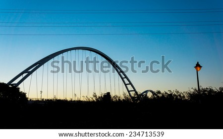 curve bridge at sunset time - stock photo