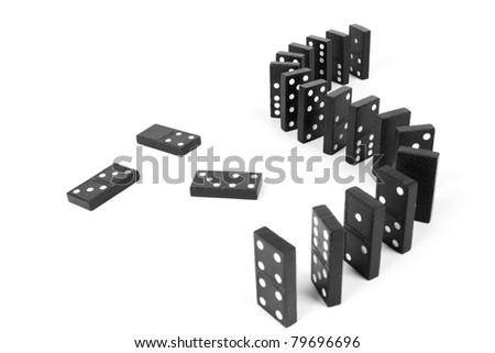 curve line domino, domino line up curve and a few of black wooden domino. - stock photo