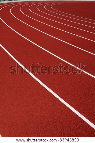 Curve of a Red Running Track and Lanes - stock photo