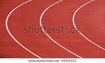 Curve of a running tracks on stadium - stock photo