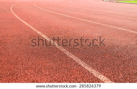 curve of  athletic running track lane - stock photo