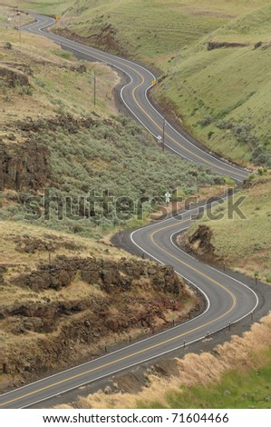 Curve of road in desert at washington state, usa - stock photo