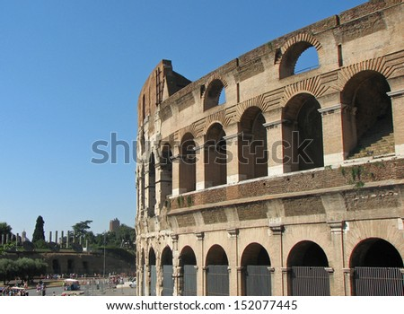 curve of the Colosseum with a view of the fori imperiali spectacular monument of ancient Rome in Italy - stock photo