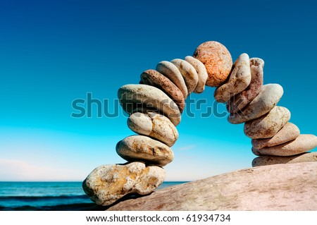 Curve of the pebbles on the sea coast - stock photo