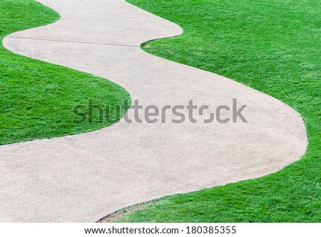 Curve pathway on the fresh grass of golf course - stock photo