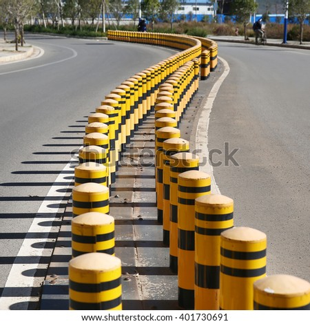 Curve road guardrail pole in urban highway - stock photo
