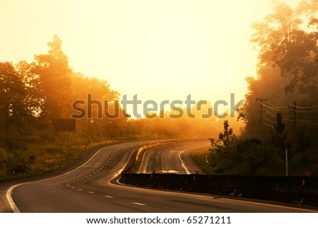 curve road in morning sunshine - stock photo