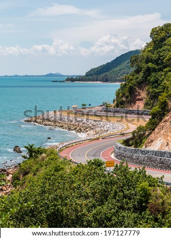 Curve Road on the Cliff by the Sea - stock photo