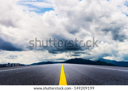 Curve road over blue sky - stock photo